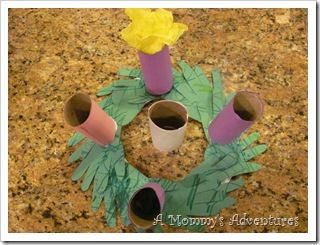 """advent wreath. cut out handprints; glue to paper plate which has center removed. cover paper towel rolls with construction paper. """"Light"""" candle by stuffing with yellow tissue paper"""
