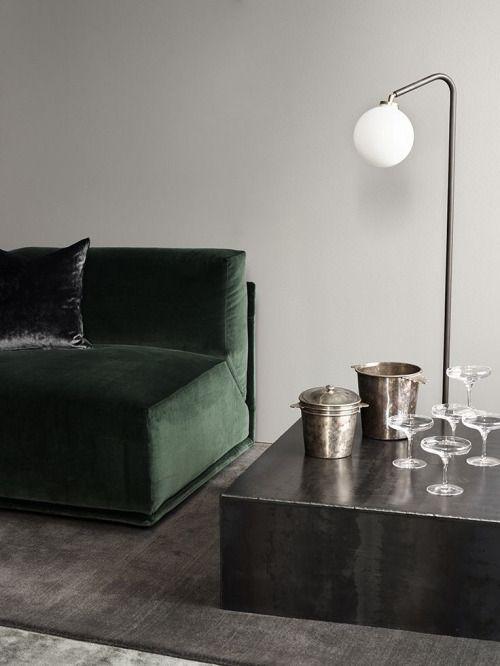 Green velvet couch and dark grey metallics