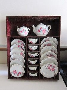 Porcelain tea set for child in pink and white