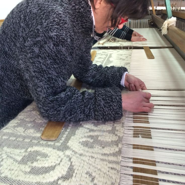 Isa at the loom in her studio
