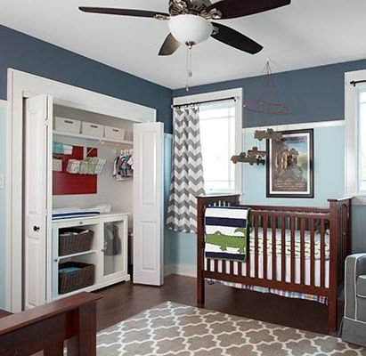 A closet built-in for the boys' room frees up wall space. Pegboard above the dresser/changing table holds baskets for diapers and other necessities.