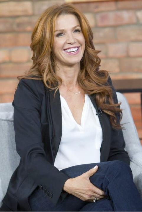 Poppy Montgomery from Unforgettable, Hair by Justin German, Makeup by Susana Hong, Manicure by Leeanne Colley (Please keep credits intact)