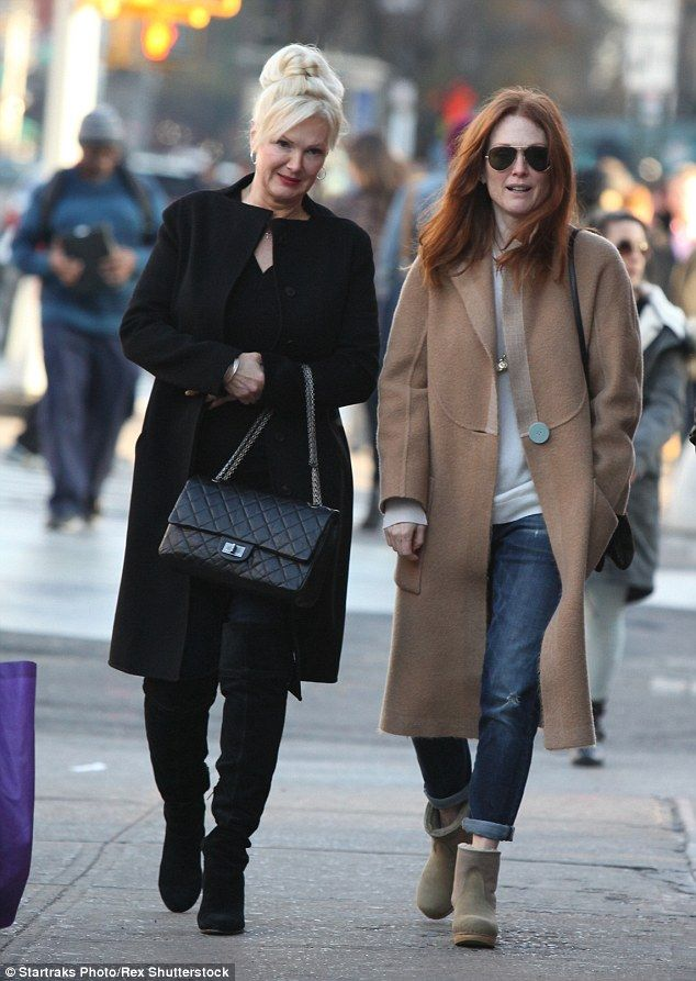 Casual style: Actor Julianne Moore wore a long camel coat over a relaxed boyfriend jeans w...