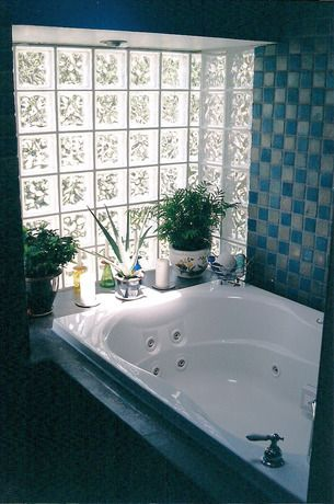 Glass block windows are the greatest things to ever happen to bathrooms. No need to close/open curtains or blinds!
