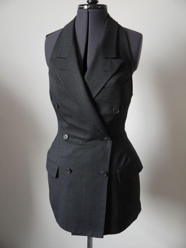 Refashioned men's suit jacket into fashionable women's suit top. Love it!
