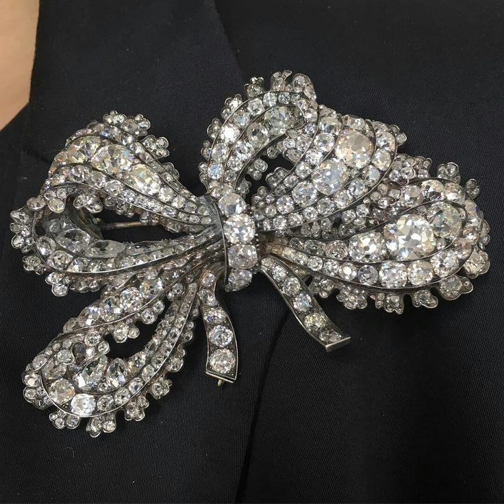 Beautiful 19th century bow brooch packed with thick old cut diamonds, mounted in silver and gold, 9.5cm wide. @christiesjewels @christiesinc