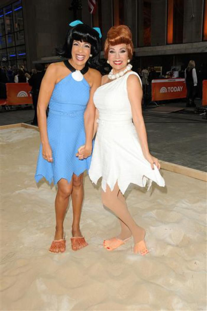 """Hoda Kotb and Kathie Lee Gifford pose as Betty Rubble and Wilma Flintstone from """"The Flintstones"""" as part of Halloween festivities on the """"Today"""" show..."""