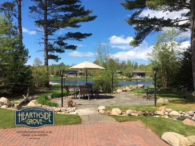 Hearthside Grove Luxury Motorcoach Resort Lot 135 - #exterior #creek #stone #brick #pavers #patio #pond