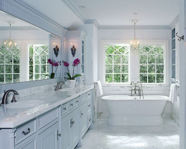 So pretty. I love how the mirror reflects the windows, adding that much more light to this already light-filled bathroom. And the chandelier above the bathtub is an added bonus.