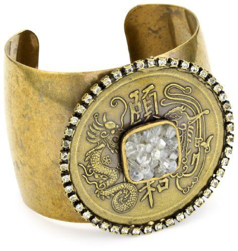 "Liz Palacios ""Orient Express"" Gold Dragon with Rock Crystal Square Center Cuff Bracelet Liz Palacios. $55.12. Made in United States. Centered with a small square filled with crystals. Gold plated cuff with large medallion encircled by Swarovski crystals. Save 62%!"