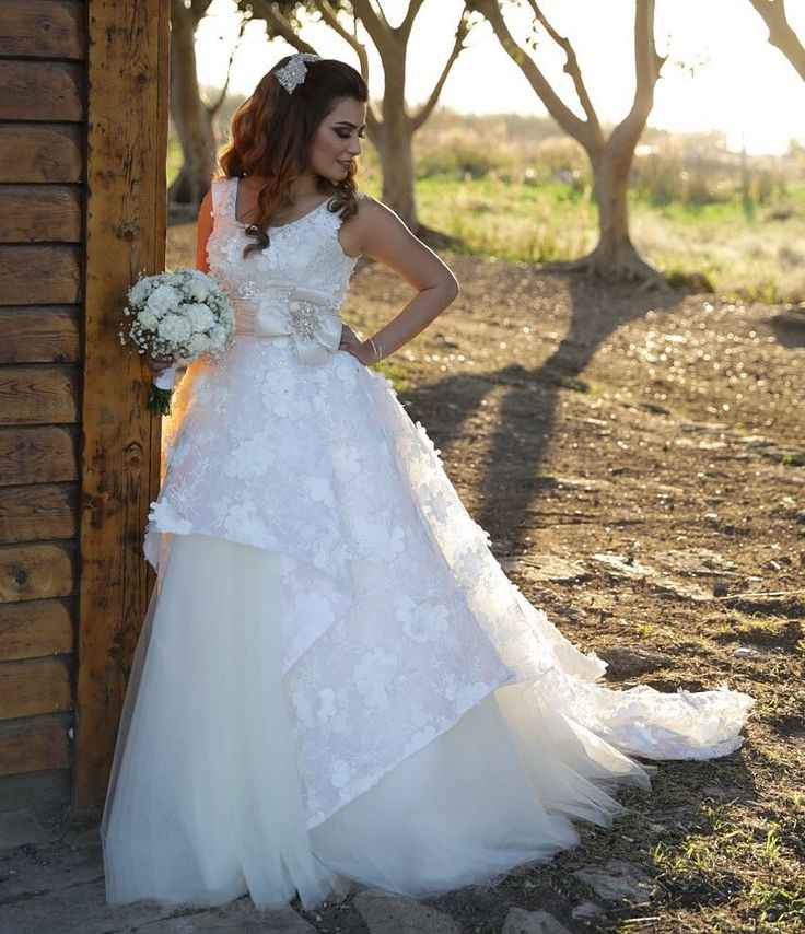 Custom made wedding gown in tulle and embroidered organza with 3D flowers by Bourhan Basma Couture