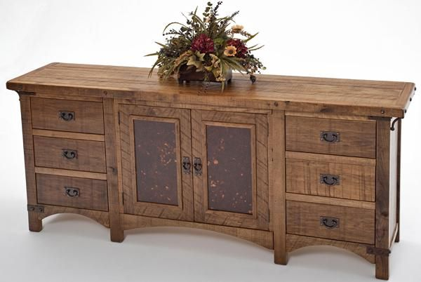 This refined rustic sideboard from our Bungalow Collection features two doors and 6 drawers – plenty of space to hold all your possessions. This elegant rustic craftsman style cabinet is made from Midwest butternut with cross cut timber, iron corner cells, hinged pulls and corner iron corbels. The doors on this sideboard feature reclaimed metal