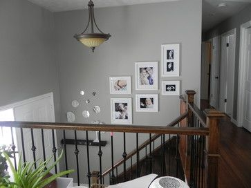 bi-level entry split entry staircase stairwell stairs decor picture frame layout