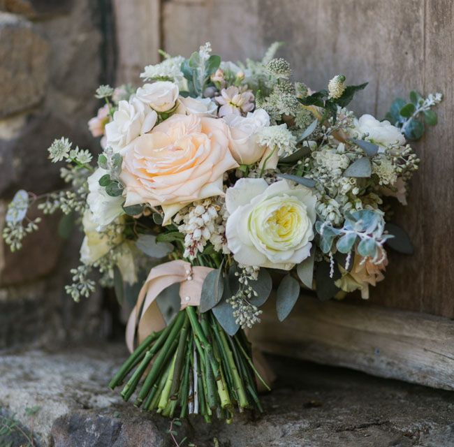 romantic hand-tied rose and pieris bouquet by The Little Branch