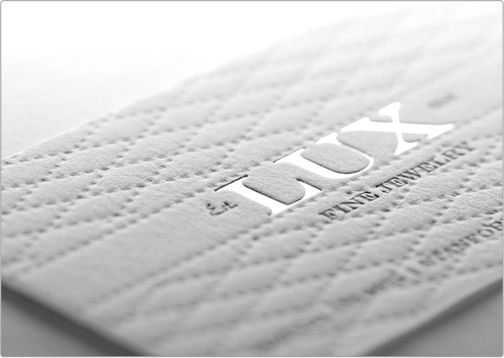 LUX business card with deboss pattern and pressed silver foil lettering. Gorgeous design.