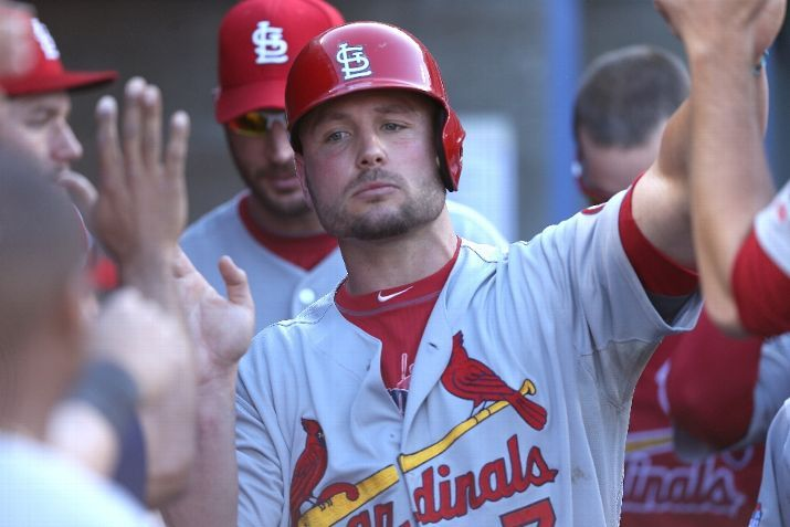 Matt Holliday celebrates in the dugout after scoring a run in the ninth inning against the Los Angeles Dodgers in game 5 of the NLCS. Cards lost the game 6-4 but lead the series 3-2.  10-16-13