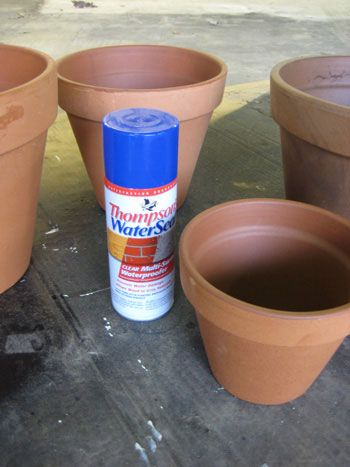 Thompson's Water Seal from Lowe's which isor sealing terra cotta pots so they can be painted. $4 Spray it all along the inside of the pot (the sides and the base) and it locks the moisture in so it can't seep through and cause your paint to bubble or peel. A few thin coats will look like the pots have just absorbed it all when they dry (they don't appear to be darker or shiny afterwords).