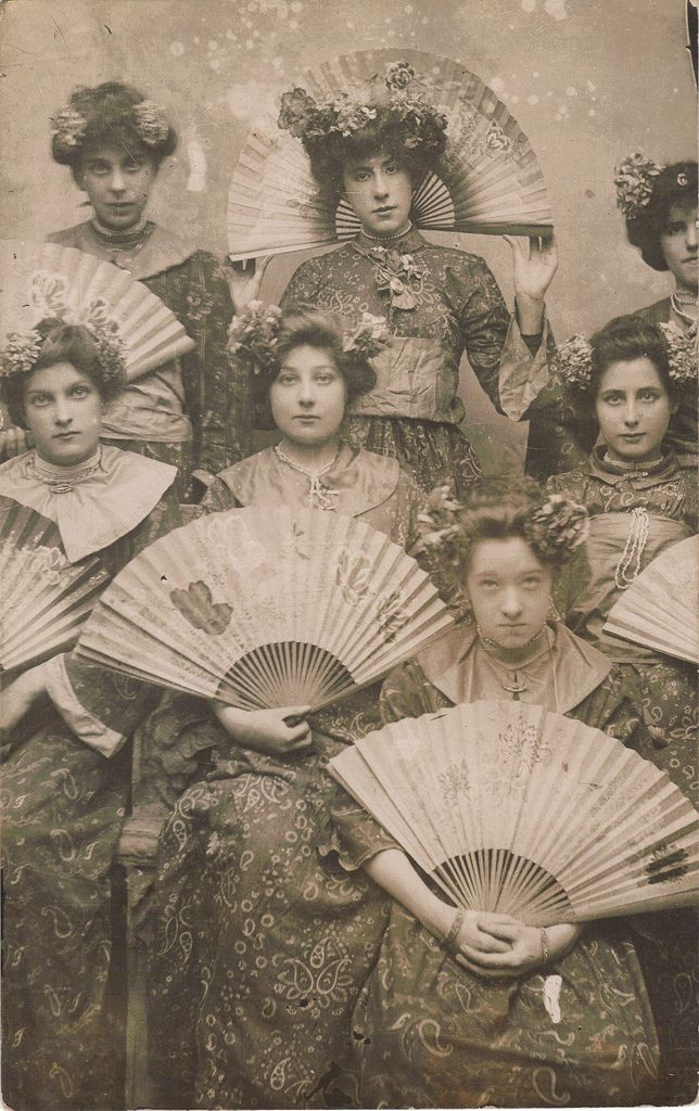 1907 Young women with Japanese fans and with their hair up in Geisha style.