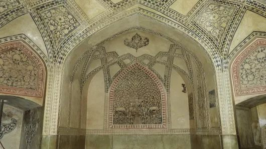 The Luxury Bath: A chamber inside the main hall of Arg of Karim Khan (Citadel). This chamber was functioned as a bath spa, in which the room is decorated in red tile arc border within cream wall with depiction of animal and plant as symbol of fertility.  The castle was an official residence of Karim Khan, the ruler of Zand Dynasty and completed in 1767 AD. Shiraz, April 2017