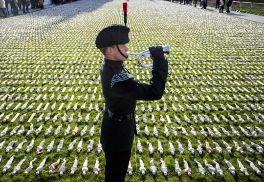 BRISTOL, UK 2016 A two-minute silence is observed on College Green where 19,240 shrouds made by Somerset artist Rob Heard mark the 100th anniversary of the battle of the Somme on Nov. 11