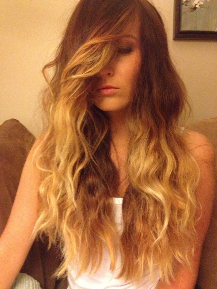 Long brown hair with highlights / haircolor / ombre / side part / side swept bangs / wavy hair / balayage / layers / model Callie Vega