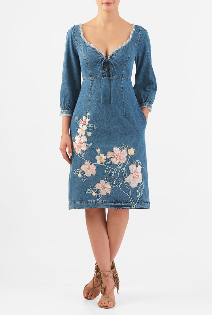 Our vintage wash cotton denim dress in a flattering empire silhouette is styled with a flirty low and wide sweetheart neck with frayed fringe trim and lace-up ties. Floral embellishment adds to the soft femininity of the look.