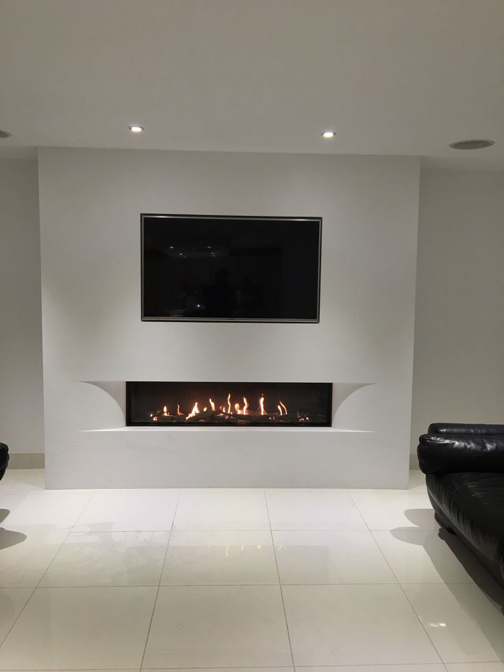 Tulp balanced flue gas fire with the superb undercover shaped fascia set in a false chimney breast with fully inset TV.