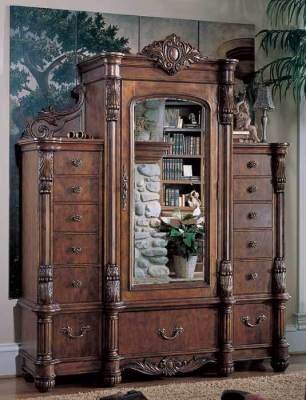 "Victorian Armoire - Worthy of one's finest personal accoutrements, this exquisitely crafted cabinet is inspired by the massive freestanding closets that our grandparents knew. 81x24x81""."