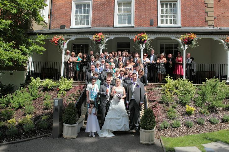 A large group shot on the front steps at Brandshatch Place Hotel.