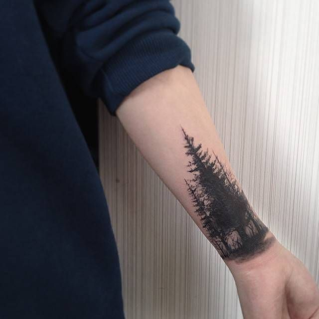 Blackwork style forest tattoo on the forearm. Done by Muha Lee