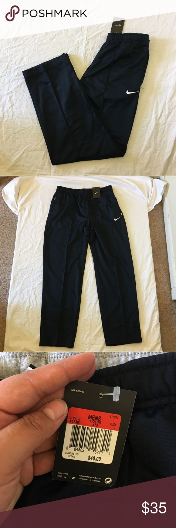 """Nike Logo Navy Track Athletic Pants Type: Pants  Style: Wide Leg  Brand: Nike  Color: Navy  Condition: new with tag Country of Manufacture: Thailand  Material: 100% Polyester  Measurements: Waist: 15"""" inseam: 31"""" length: 41"""" Nike Pants Sweatpants & Joggers"""
