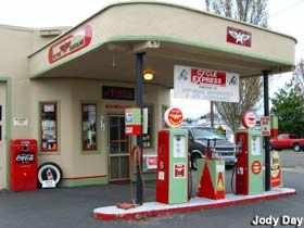 "Someone has very lovingly restored a vintage Flying A gas station back to its original glory. Instead of operating as a gas station, it is an ATV accessories store called ""Cycle Express."" Gladstone, OR"
