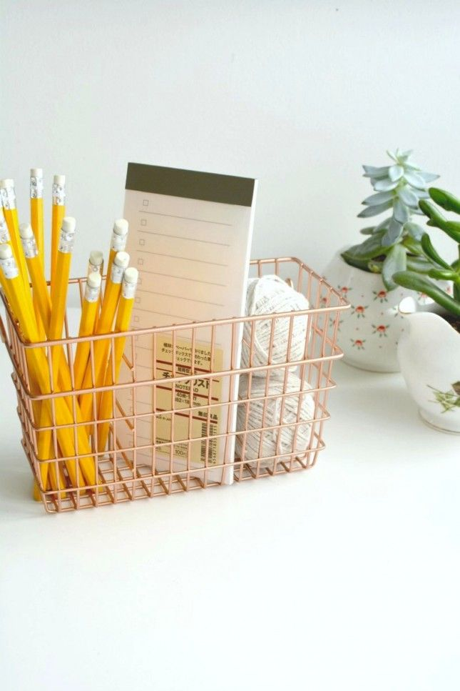 Clean up your desk with a copper wire organizer.