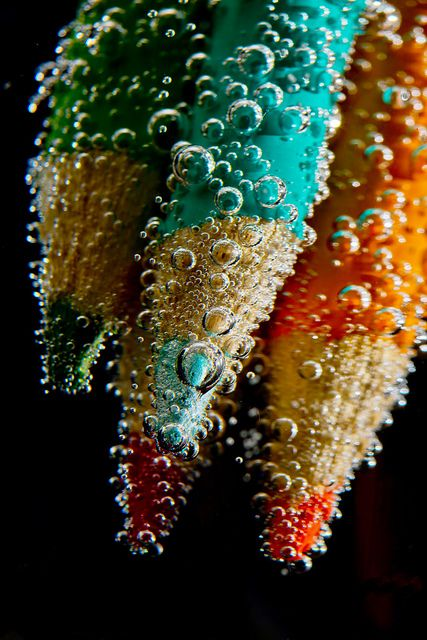 Pencils being plunged underwater | Steve McDermott (Doogle510), on Flickr. Such a cool macro action shot! Love the bubbles.