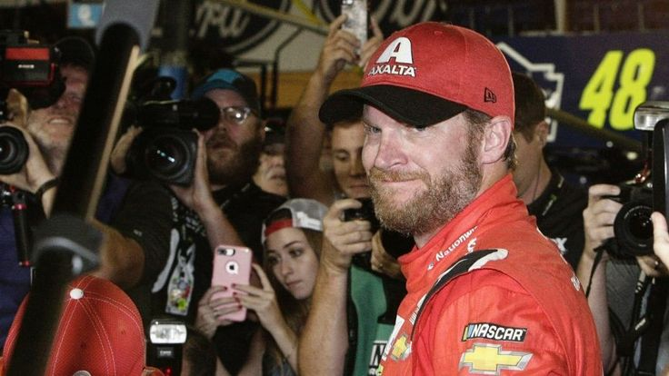 Dale Earnhardt Jr. is surrounded upon getting out of his car after a NASCAR Cup Series auto race at Homestead-Miami Speedway in Homestead, Fla., Sunday, Nov. 19, 2017.