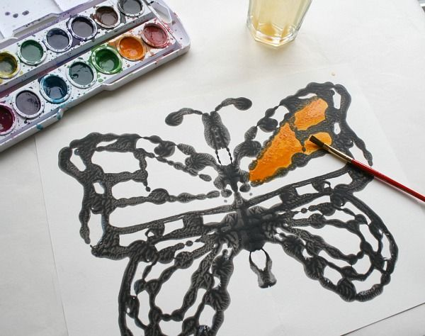 Kids love making these monarch butterflies with black glue and watercolors! ~ Buggy and Buddy