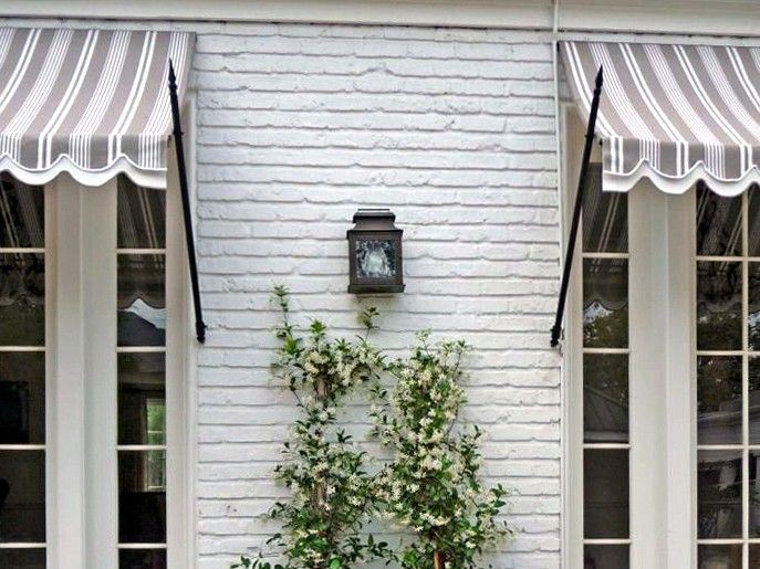 I have always loved awnings.  Especially love the hardware on these