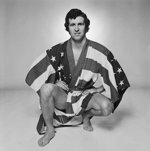 "Peter Osgood American Flag by Terry O'Neill. Chelsea and Southampton footballer Peter Osgood (1947 - 2006) poses in a stars-and-stripes dressing gown, circa 1975. Limited Edition Silver Gelatin Signed and Numbered - 16"" x 16"" / 20"" x 20"" / 24"" x 24"" / 30"" x 30"" / 40"" x 40"" / 48"" x 48"" / 60"" x 60"" / 72"" x 72"" - For questions or prices please contact us at info@igifa.com"