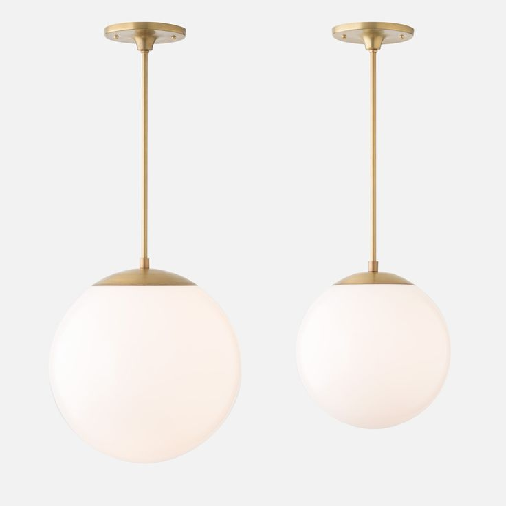 Pared down to the elements of line and light, the Luna Collection retains a delicate, sculptural quality that illuminates a room even when unlit. Paired with a slender rod and simple components, the blown glass shade emits a diffuse glow that appears to be suspended in space. We juxtaposed the globe shade with the rich warmth of hand finished Natural Brass for a sophisticated combination that transcends time.  Ideal to stand alone in a foyer or dining room, the generously sized 12