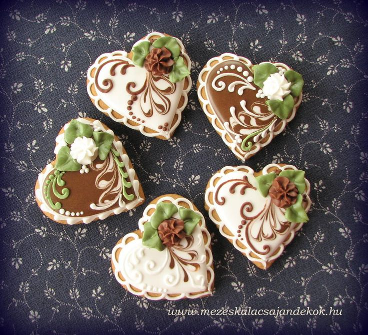 cream, brown and green heart cookies... Maybe add a red rose and take out the green? via #TheCookieCutterCompany