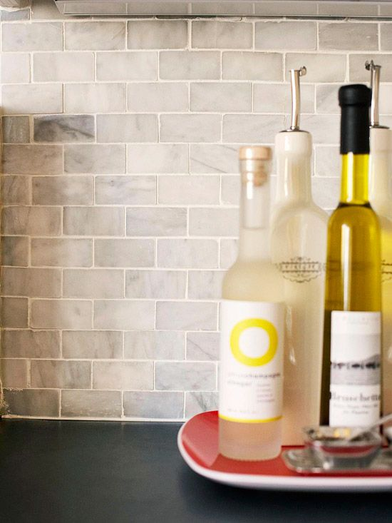 Backsplash on a Budget:  If someone can't find or afford something this high end, white subway tile  is expensive if is not  on a sheet  (though sheets make it easier when you are doing it yourself), and I could achieve a similar look.