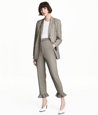 Gray/checked. Ankle-length pants in woven fabric with ruffle details. High waist, hook-and-eye fastener, zip fly, and welt back pockets. Tapered legs.