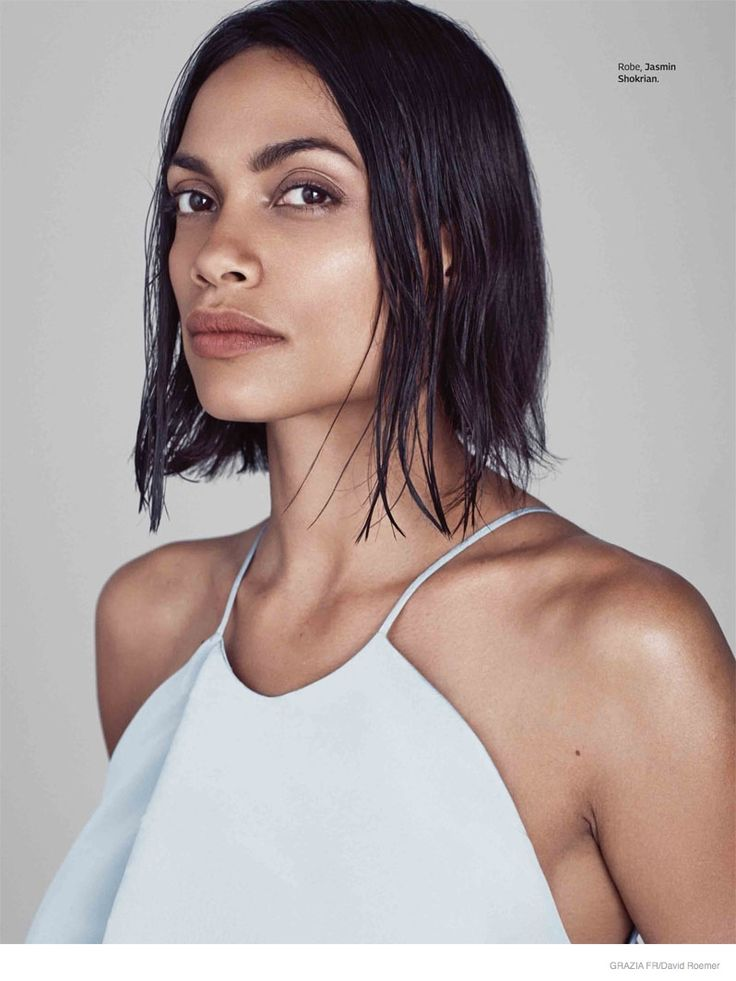 Actress Rosario Dawson is the January 2nd, 2015, cover star of Grazia France, looking minimal chic with an almost fresh-faced makeup look and undone tresses. Photographed by David Roemer of Atelier Management and styled by Nicolas Klam, the dark-haired beauty wears laid-back ensembles featuring the designs of Tommy Hilfiger, Calvin Klein, Longchamp and more.