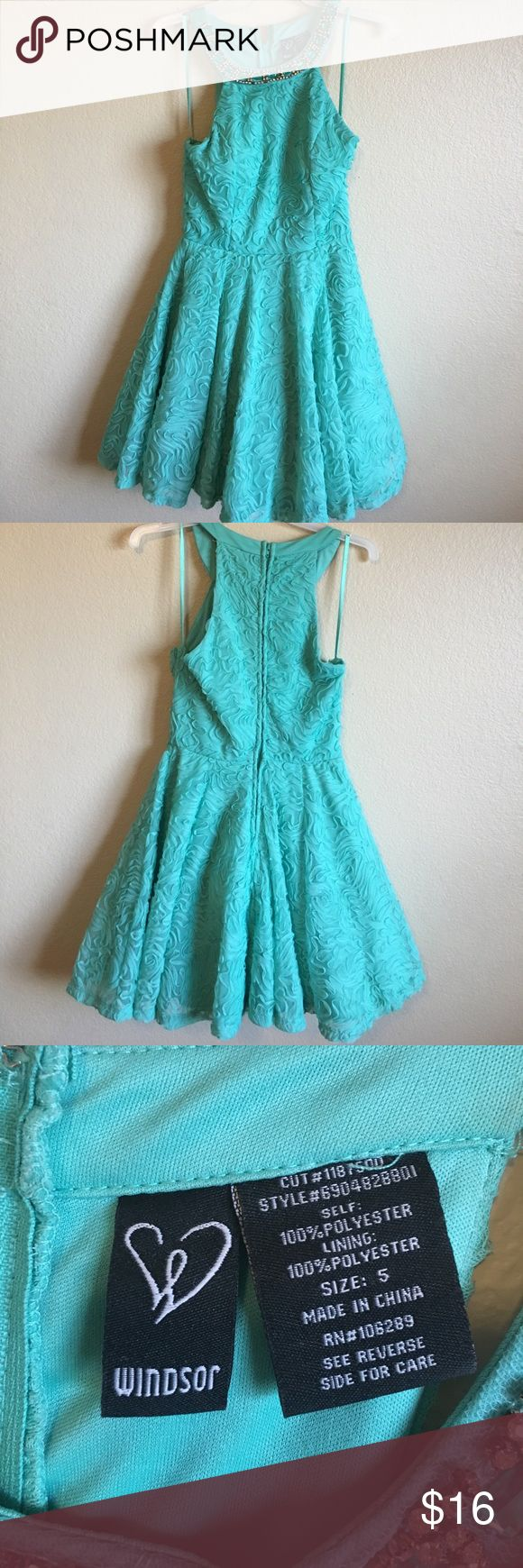 Short turquoise formal dress Short turquoise dress, worn once for winter formal. Super cute and flirty purchased at Windsor. Has a small detaching at zipper(picture shown above). Windsor Dresses Prom