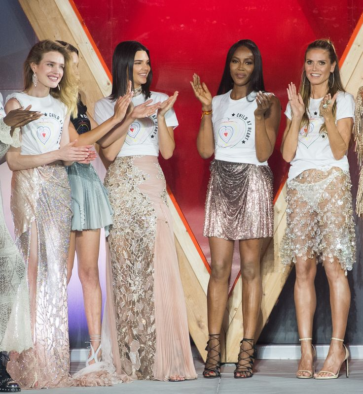 CANNES, FRANCE - MAY 21: Natalia Vodianova, Bella Hadid, Kendall Jenner, Naomi Campbell, Heidi Klum  walk the runway at the Fashion for Relief event during the 70th annual Cannes Film Festival at Aeroport Cannes Mandelieu on May 21, 2017 in Cannes, France.  (Photo by Samir Hussein/WireImage) via @AOL_Lifestyle Read more: https://www.aol.com/article/entertainment/2017/05/21/best-dressed-billboard-music-awards-2017-celine-dion/22102539/?a_dgi=aolshare_pinterest#fullscreen