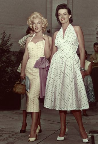 Fashion: Eleven Vintage Style Icons Marilyn Monroe and Jane Russell. A-line dresses were popular in the 1950's as well as halter tops. You can also see the hourglass silhouette.