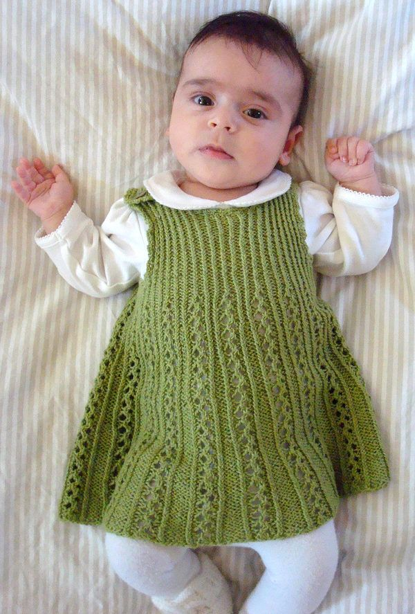 Free Knitting Pattern for Tiny Ribbon Baby Dress - The tiny ribbon lace on the skirt transitions nicely into the twisted rib of the bodice of this adorable dress. 3-6 months. Designed by Astrid Colding Sivertsen. DK yarn. Available in English and Danish.