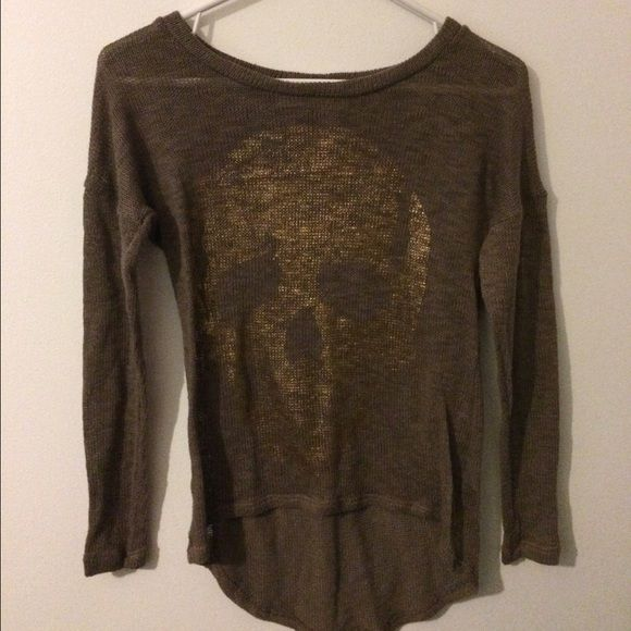 Boutique skull sweater Gold foil skull hi-lo sweater top, purchased from a boutique. Great condition, got a lot of compliments when I wore this. Sheer, cute with a tank underneath Sweaters