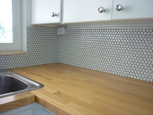 wood countertop and penny tile backsplash? in love.