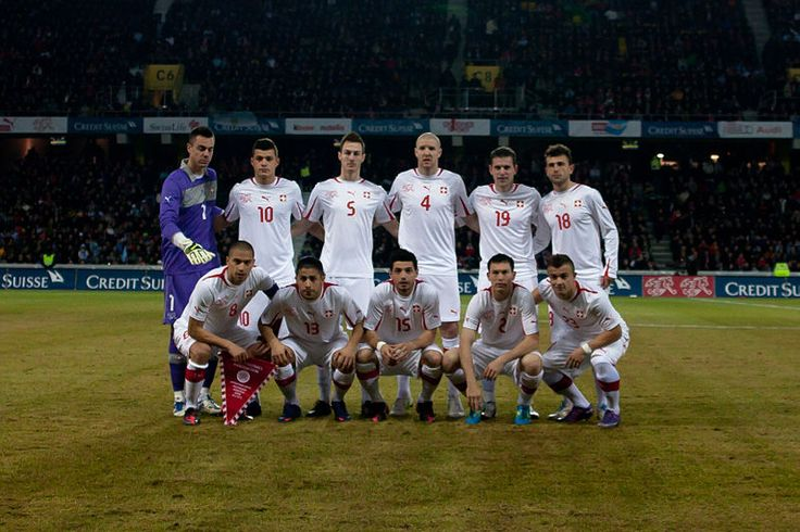 The Switzerland national football team lining up against Argentina in 2012